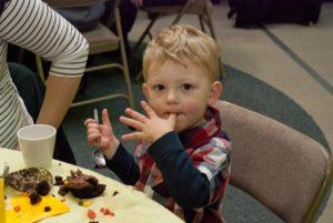 Child enjoying a cupcake