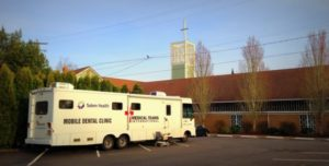 Picture of the Mobile Dental Clinic RV in the Kingwood Parking Lot