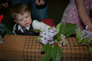 Our kids putting flowers on the cross