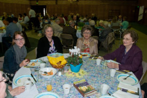 Easter Breakfast - Church Members Sitting Around Table