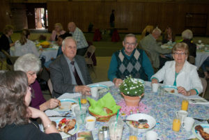 Easter Breakfast - Church Members Sitting Around Table