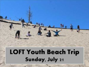 Picture of Sand Dune with Kids looking down the dune.