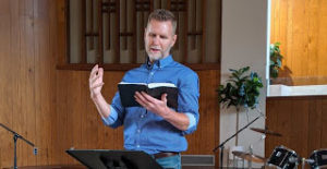 Pastor Nathan preaches from the Bible